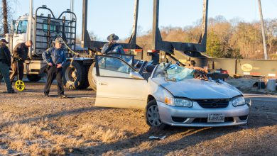 Photo of Trailer Malfunction Contributes to Car Crash with Log Truck