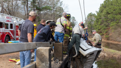 Photo of Man Rescued from Crashed Truck Hanging from Bridge