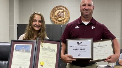 Photo of Caytlee Poole & Coach Glass- Outstanding Curley Wolves