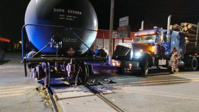 Photo of Log Truck Slams Into Train, No Injuries