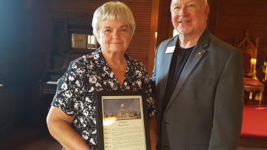Photo of State Representative Danny Watson presents an Arkansas House of Representatives citation Peggy Lloyd