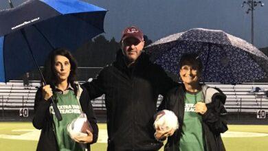 Photo of Prescott Principal Poole Presents Extra Yard Game Ball to Teachers