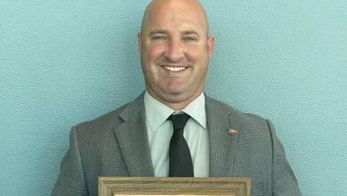 Photo of Poole receives plaque for serving as President of the Arkansas Association of School Administrators