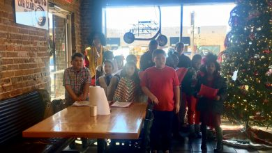 Photo of Clinton Primary G&T Students Christmas Caroling in Tailgaters Burger Co.