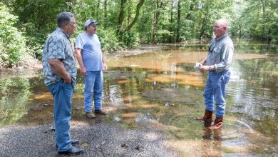 Photo of Representative Watson Tours Areas Impacted by Flood